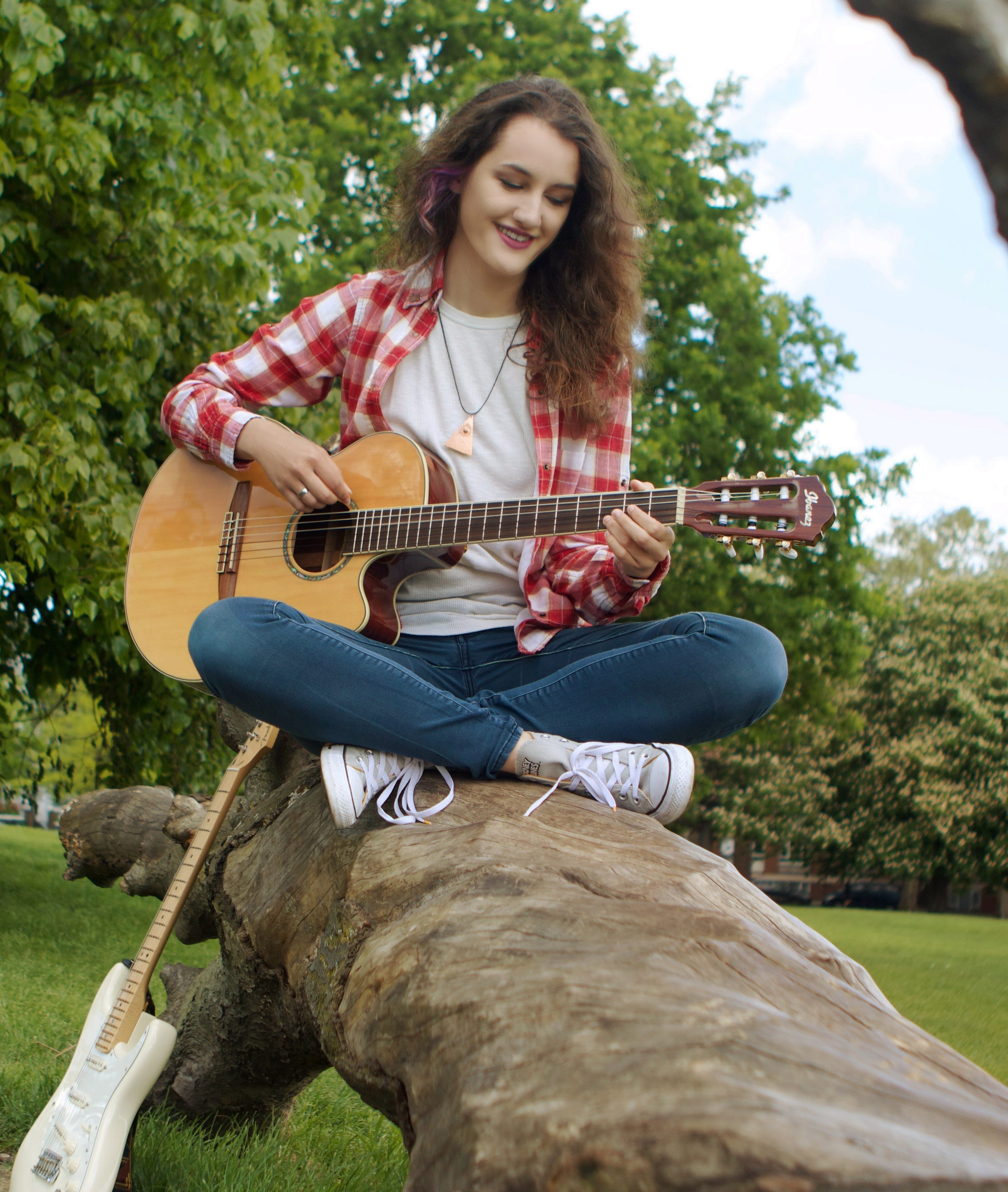 about Neli Playing Guitar in the park